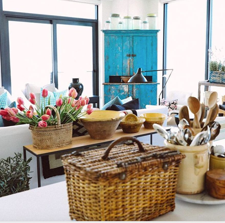 basket, table with tulips, spoons in crock, blue armoire