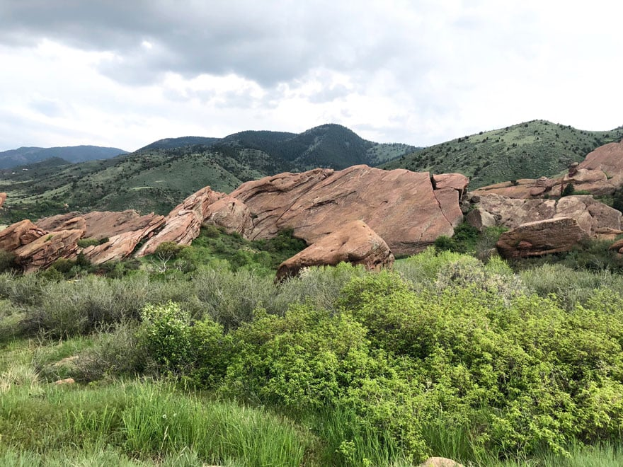 Red Rocks and green trees