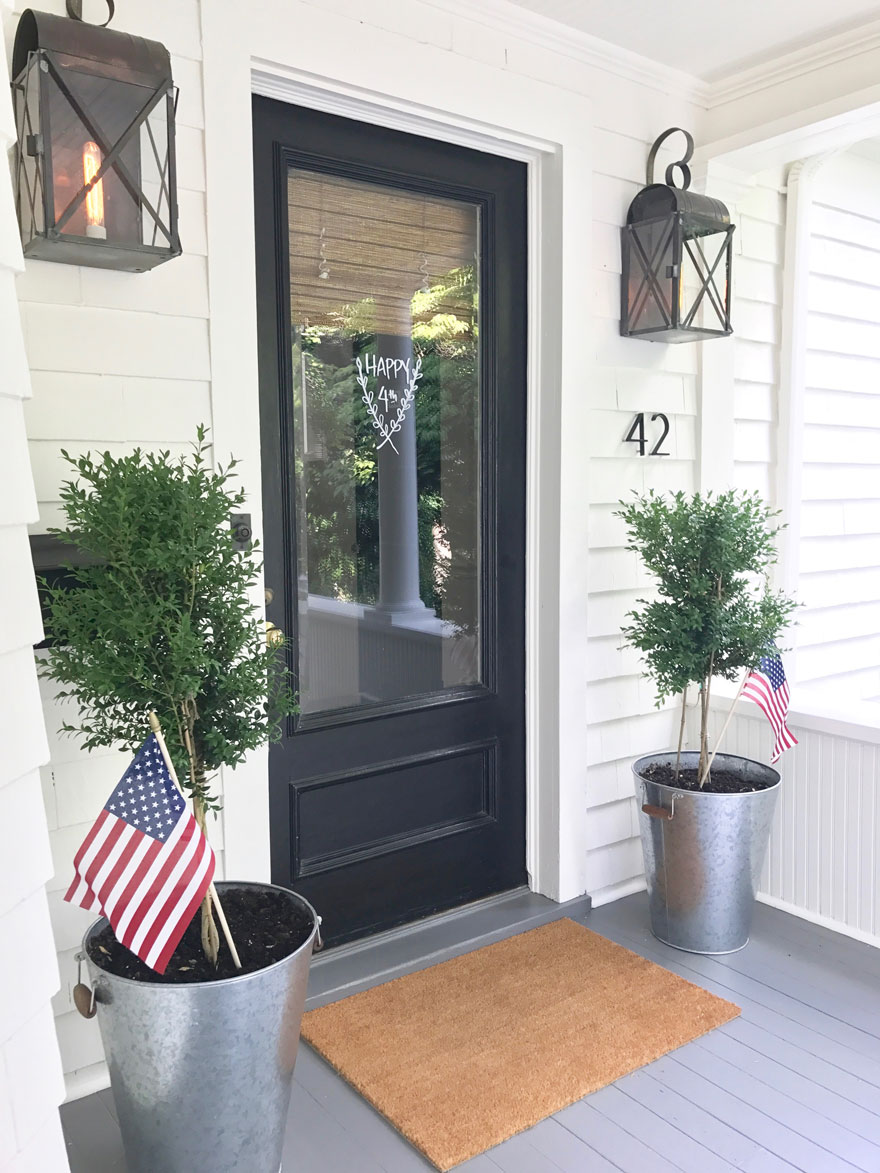 front door with planters with USA flags