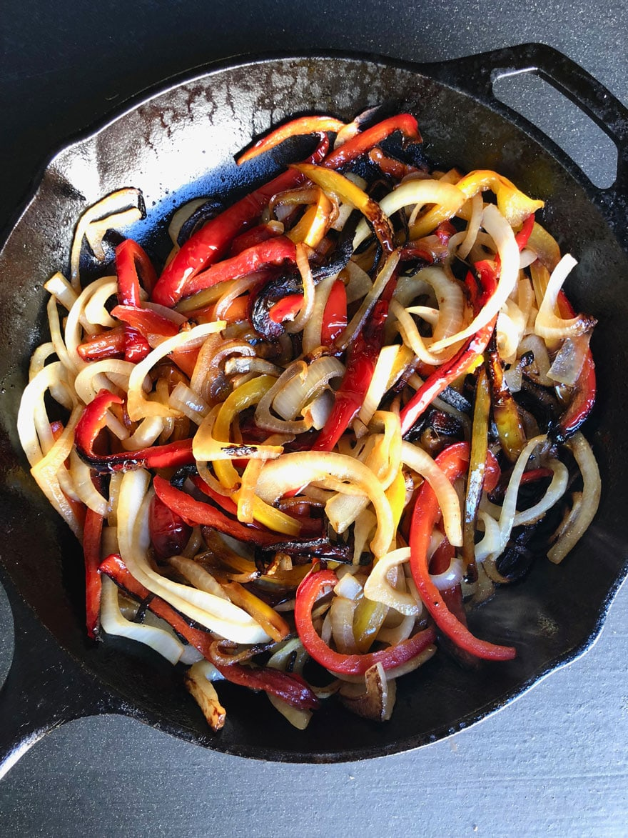 cooked peppers and onions in skillet