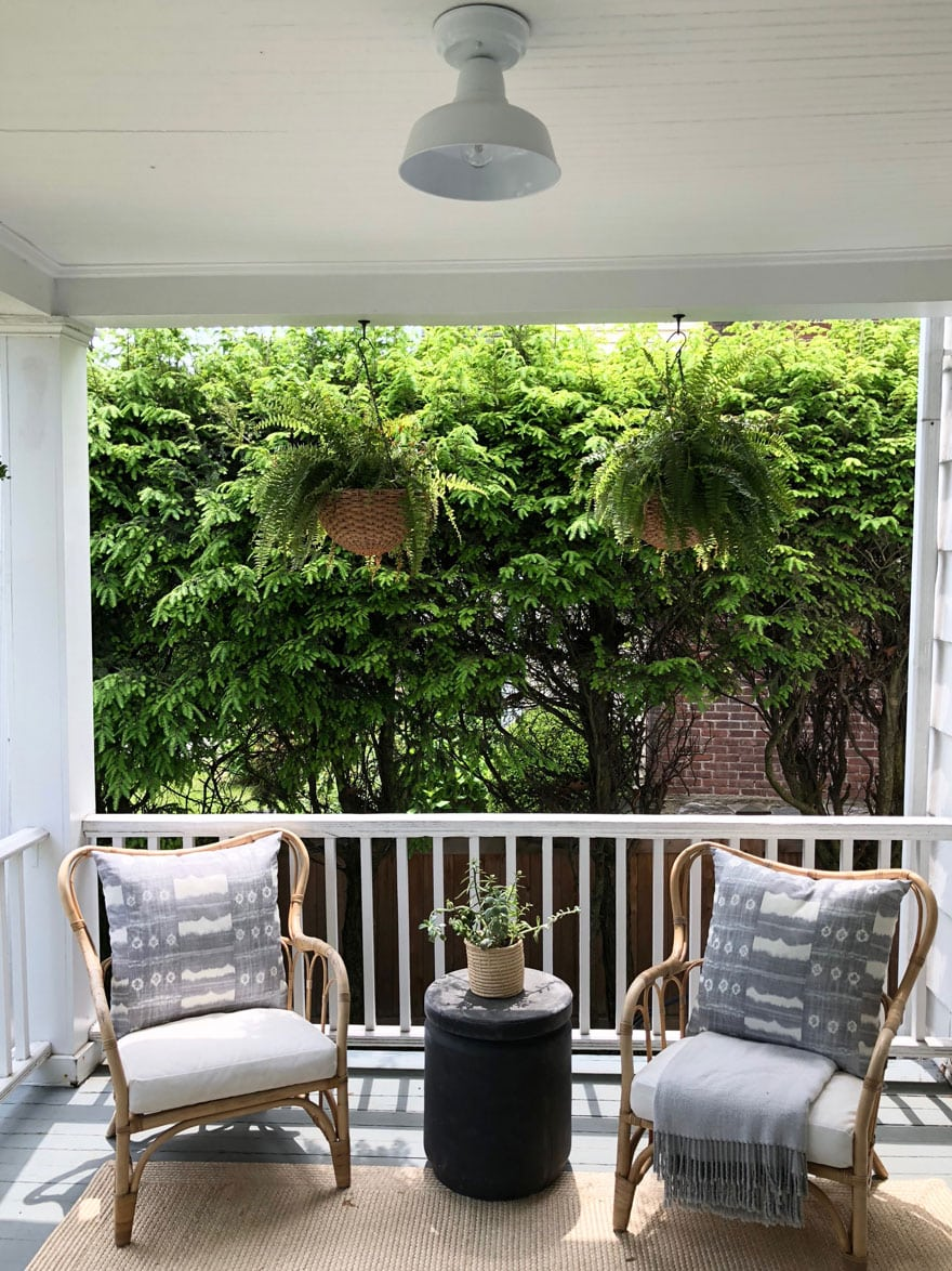 chairs on porch with hanging ferns