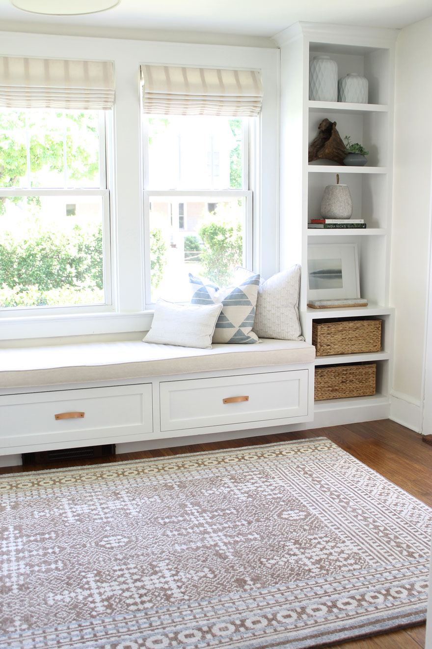 built in bench seat with cushion and book cases