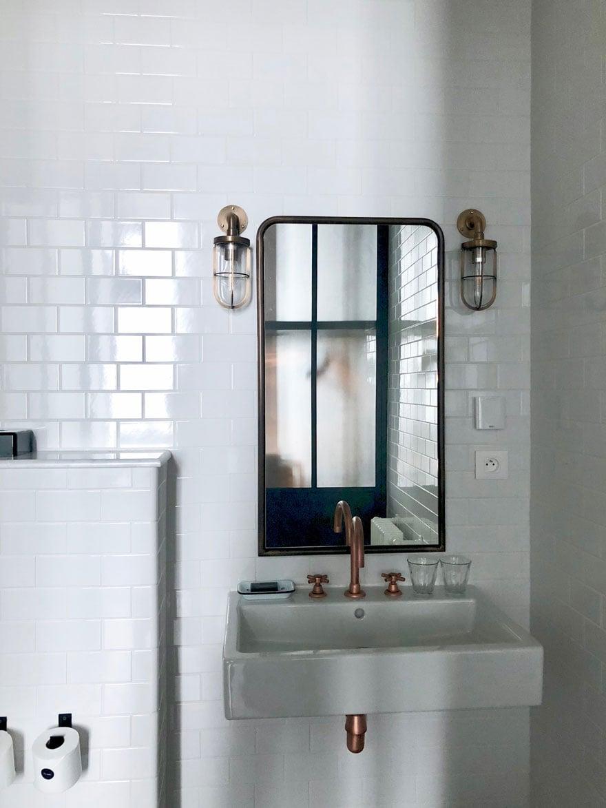 mirror, sconces, bathroom sink