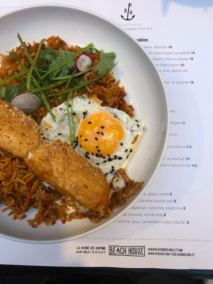 a dish of food with rice and egg