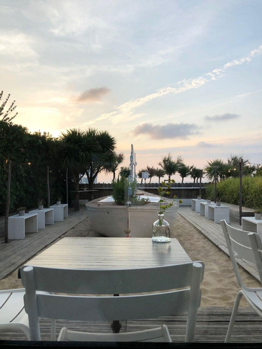 restaurant overlooking beach at sunset