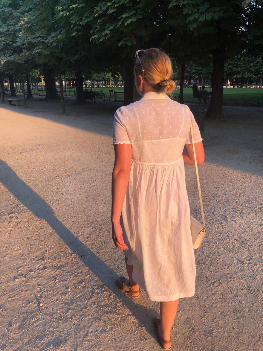 woman wearing white dress in paris