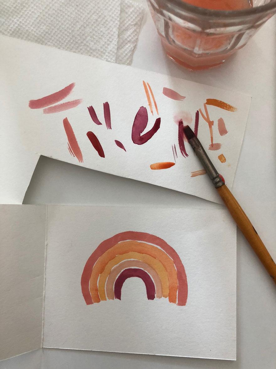 rainbow watercolors on card