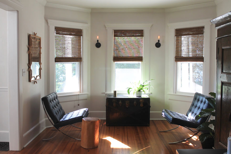 3 windows, barcelona chairs trunk sconces