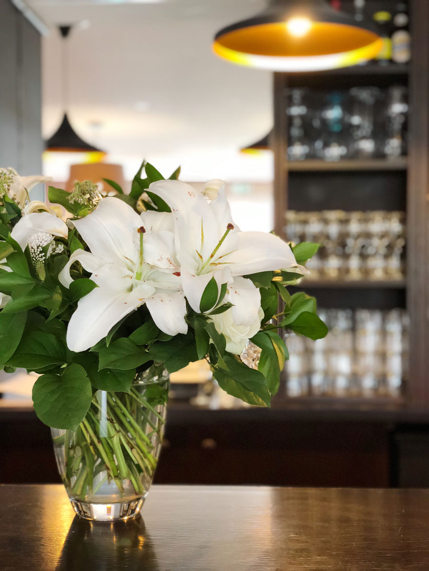 fresh white flowers on hotel bar