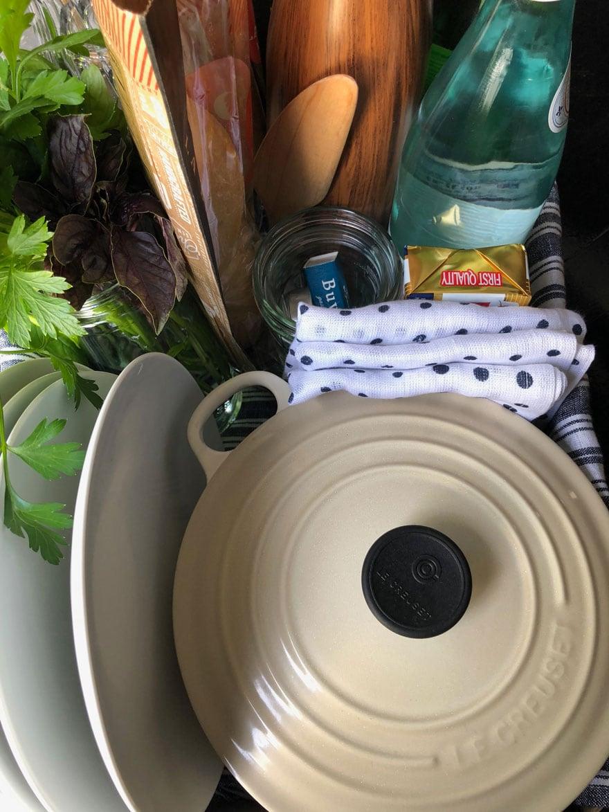 dutch oven, herbs, plates, matches, butter