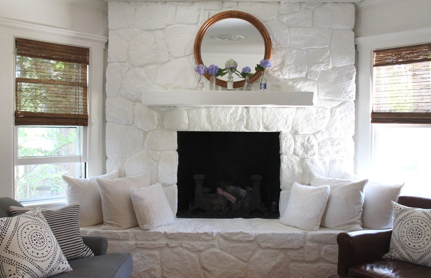 painted stone fireplace with mirror