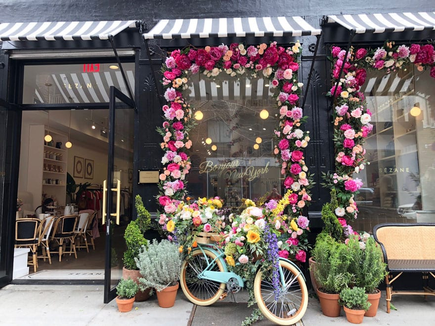 bike in front of shop window with flowers and plants