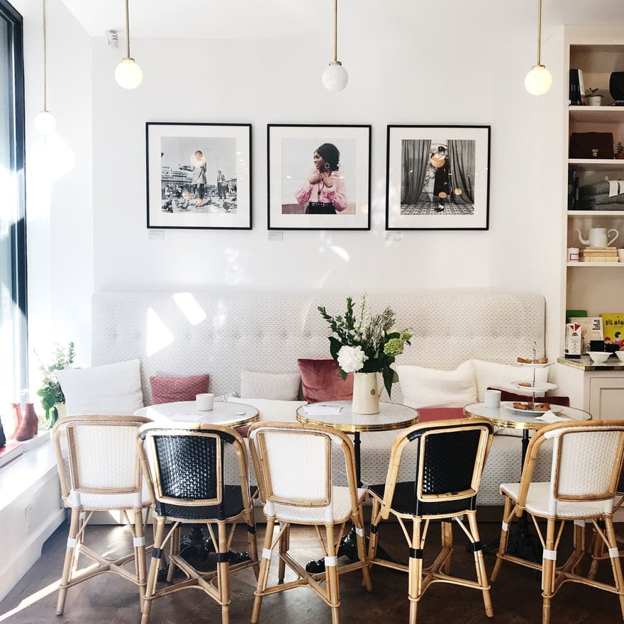 french cafe chairs and tables with art