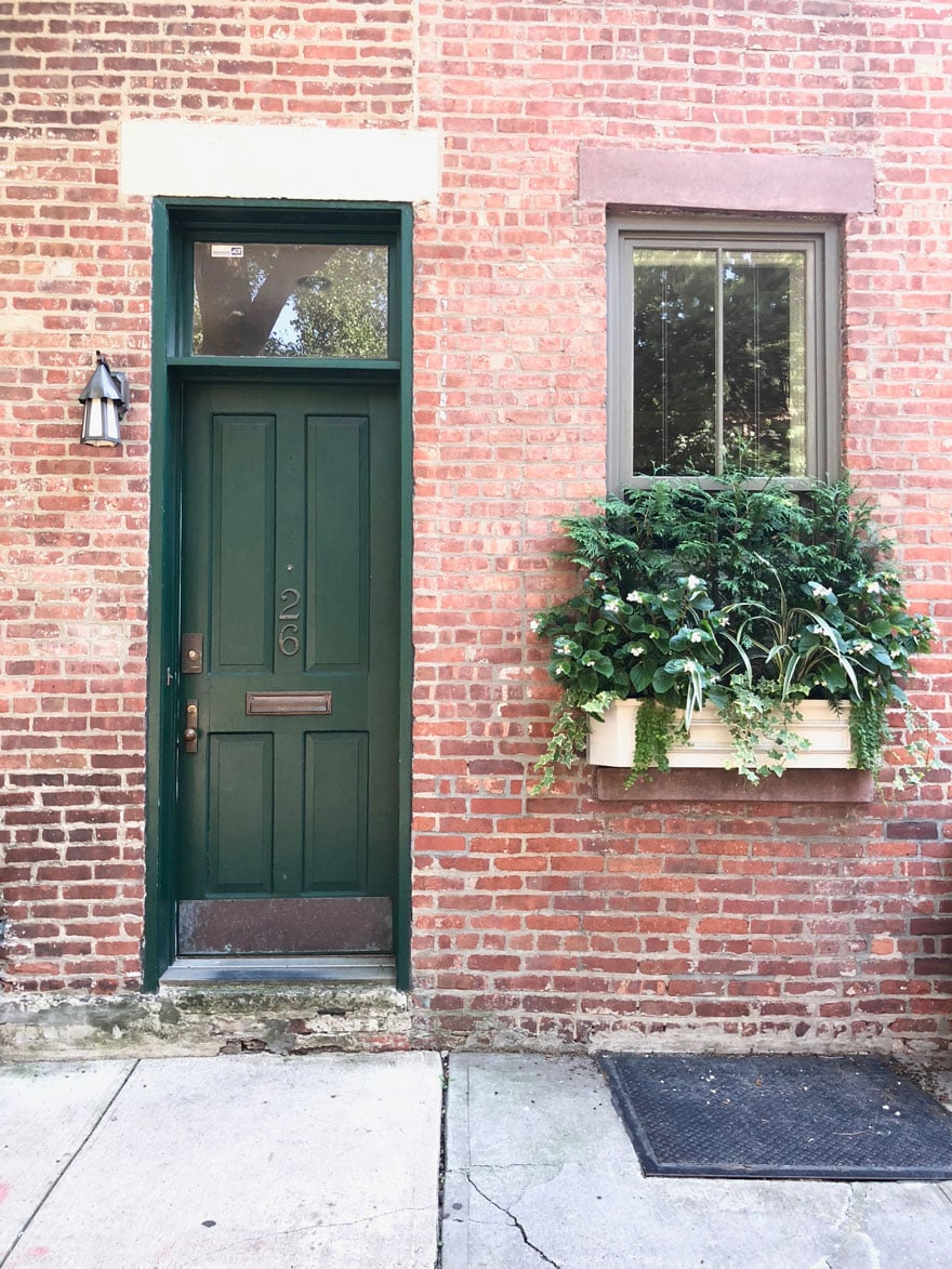 window boxes on brick townhouse in New York
