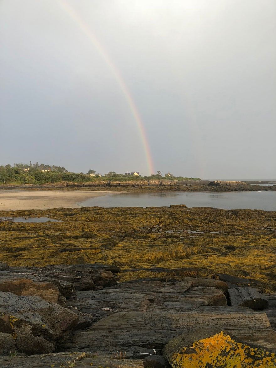rainbow at rocky beach