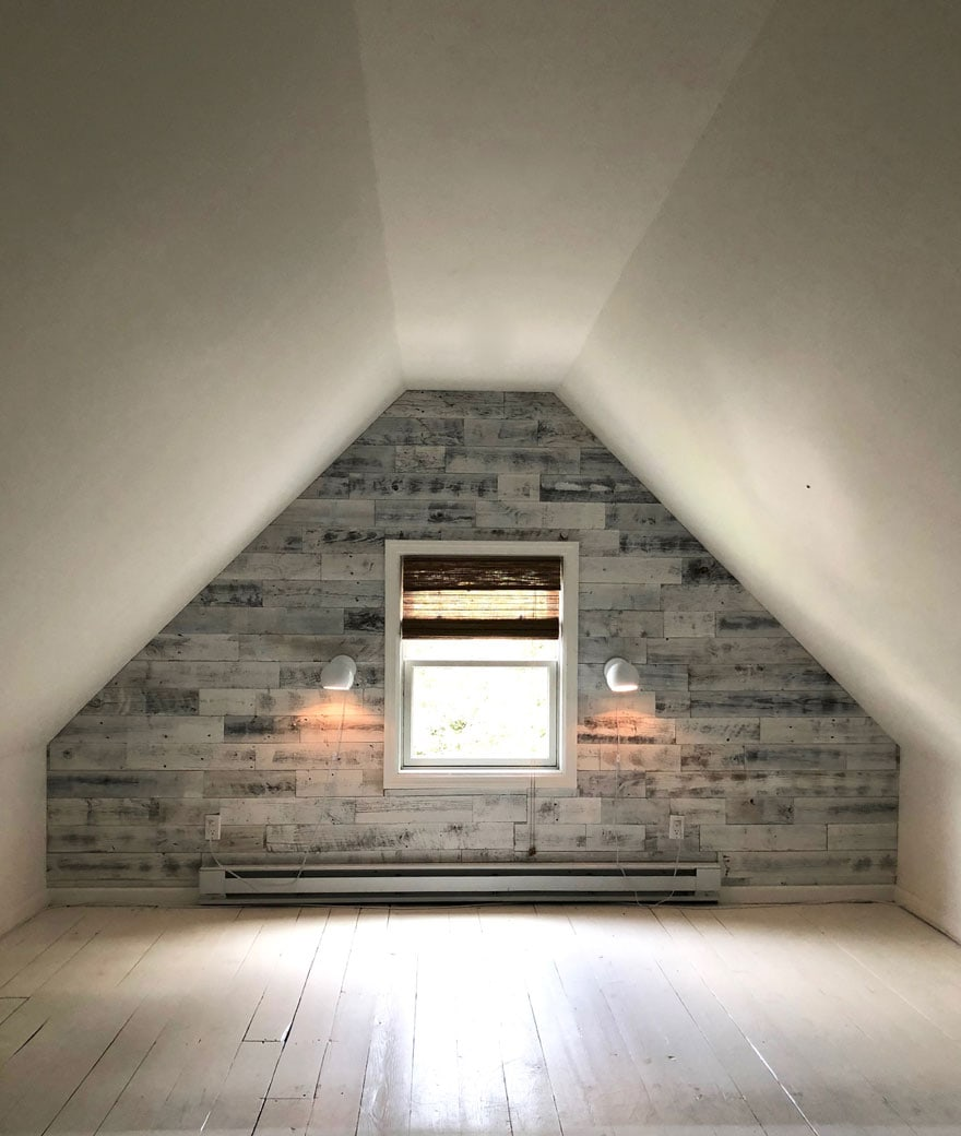 attic space with wood walls