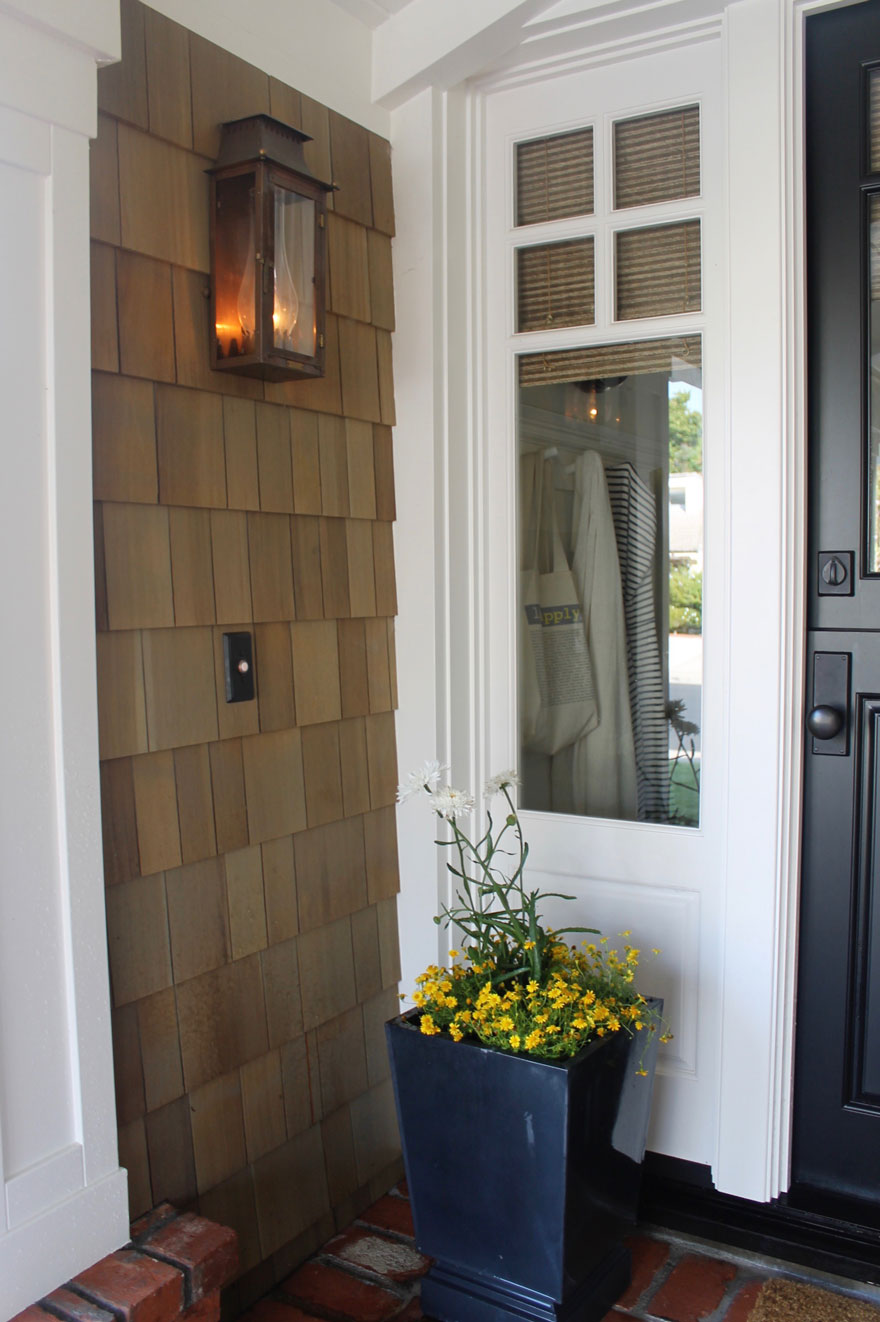 copper lantern on exterior with planter