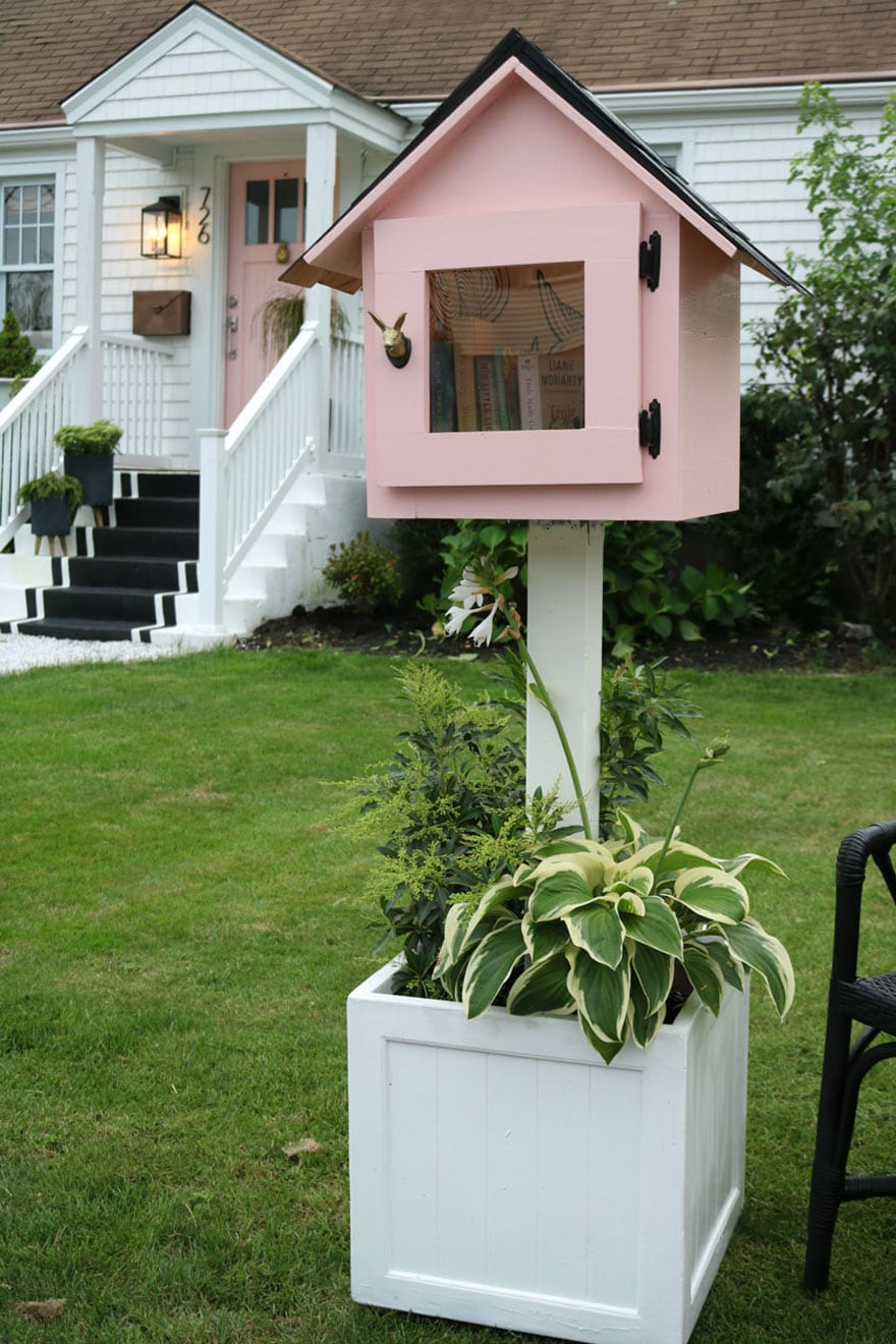 pink box in planter in yard