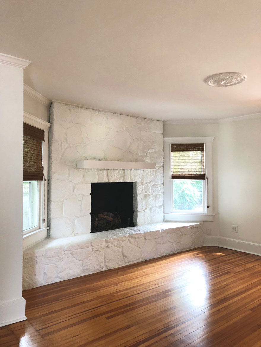 painted white stone fireplace