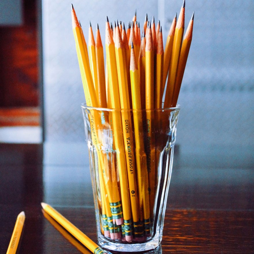 clear glass with pencils