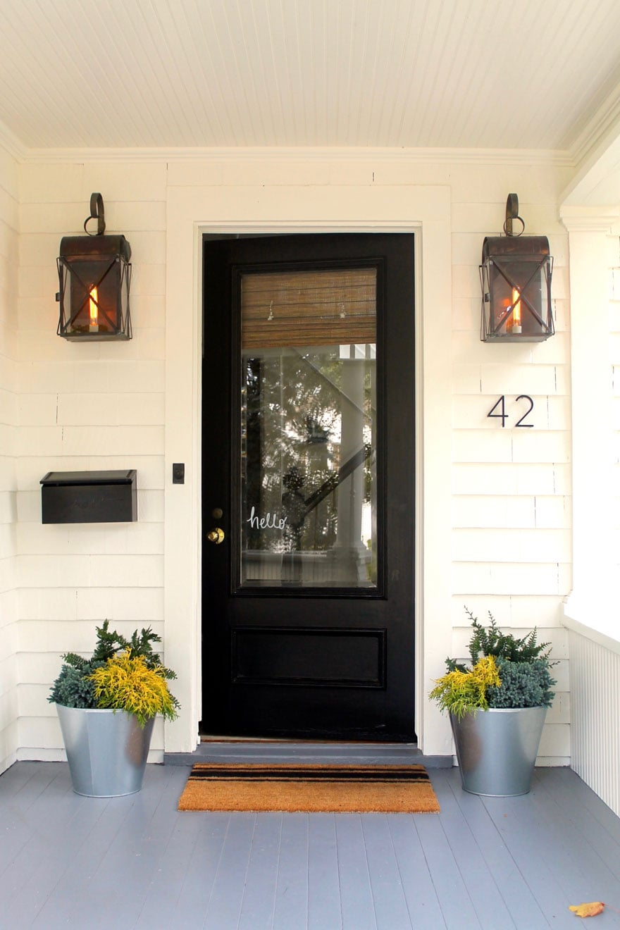 house with black door and planters