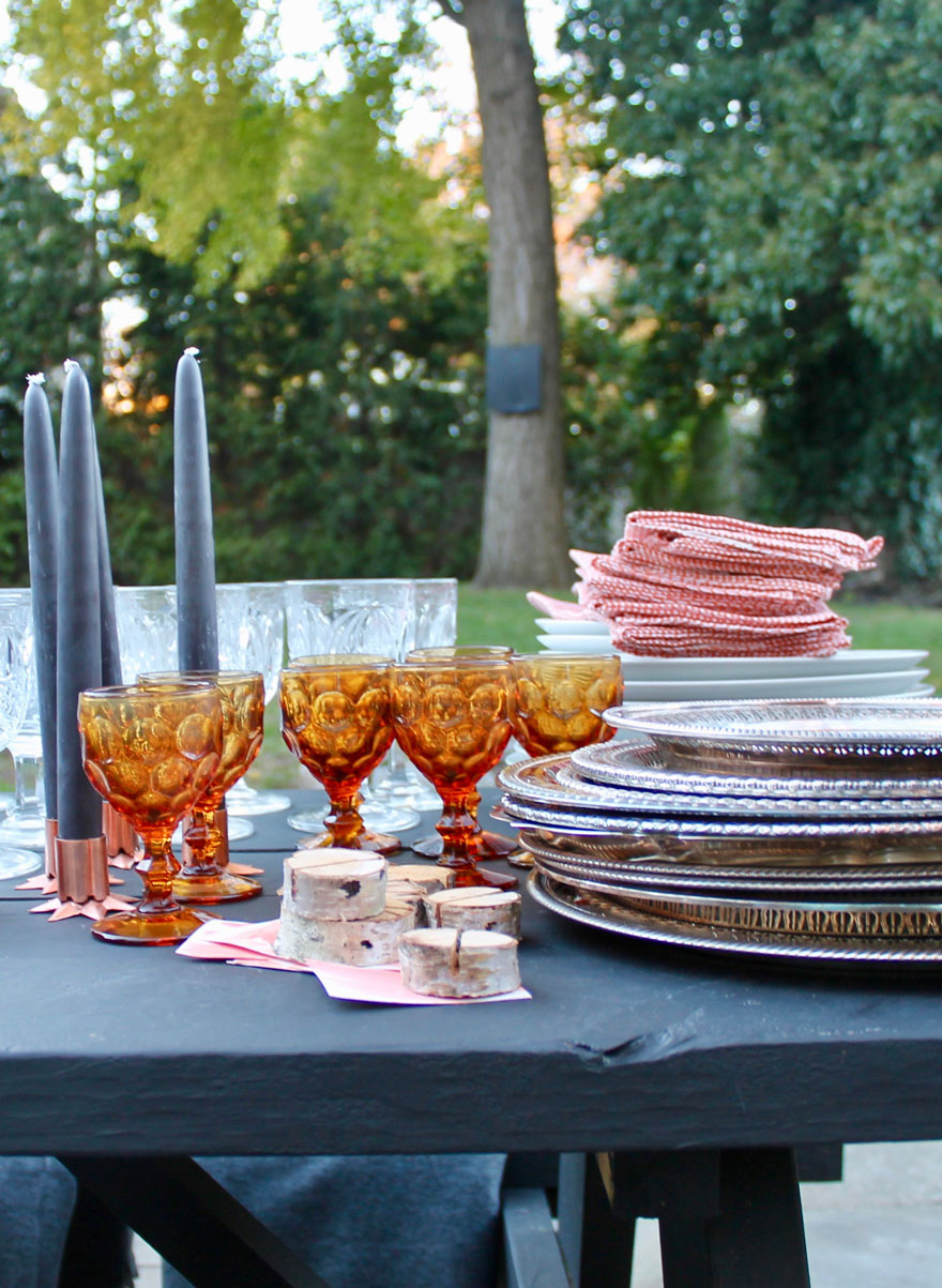 amber glassware, black candles, birch branch pieces, silver trays