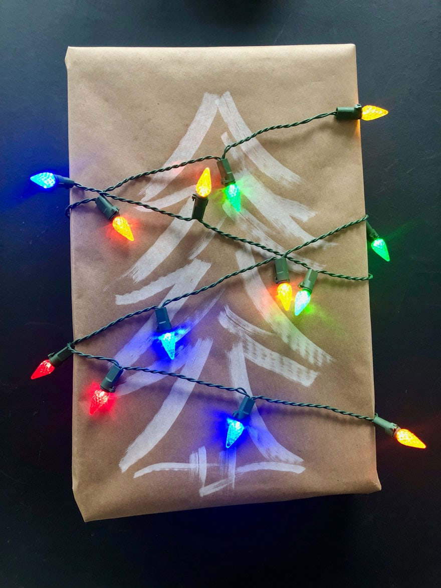a gift wrapped package with colorful lights on black background
