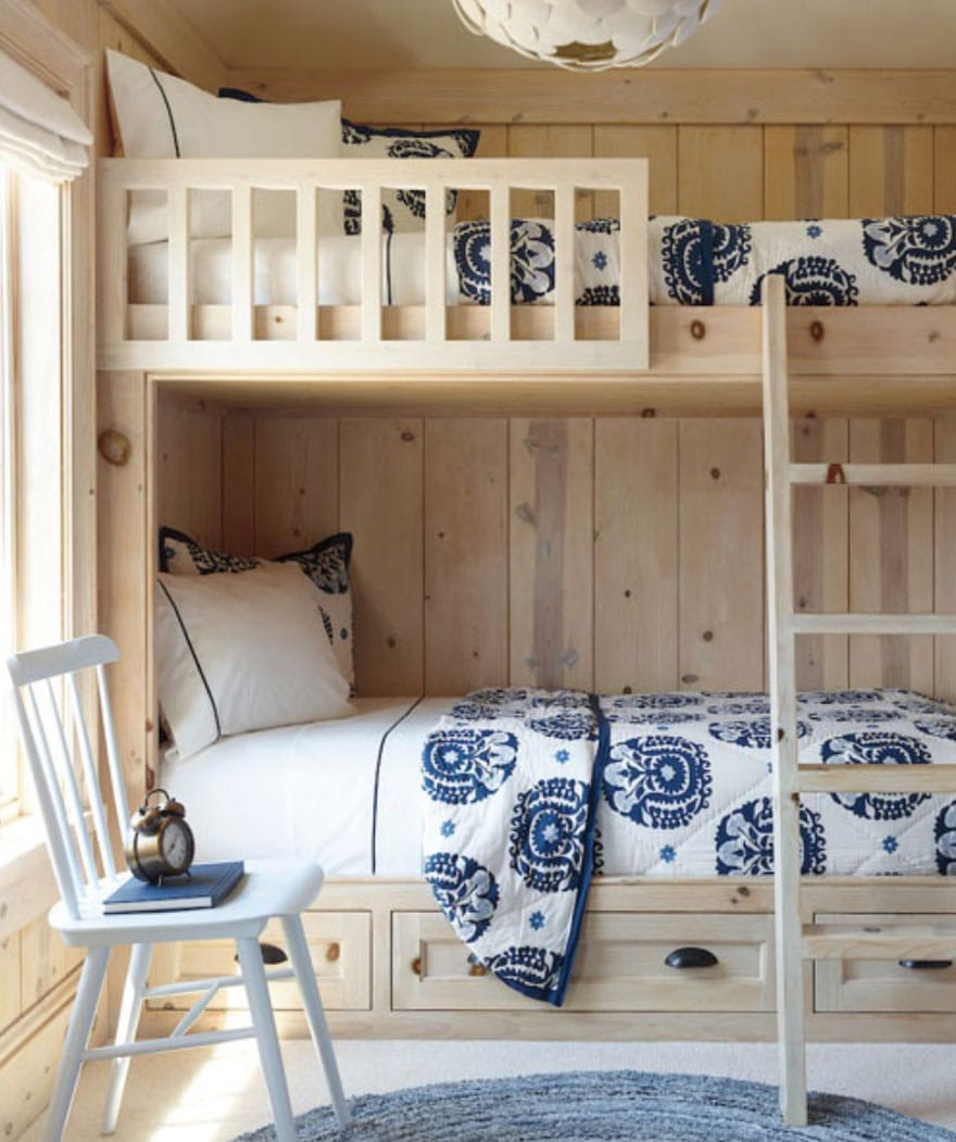 bunk beds, chair with books and clock