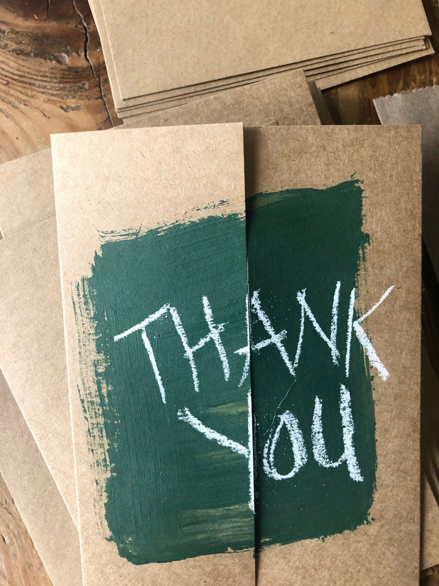 green pain on card with letters Thank you
