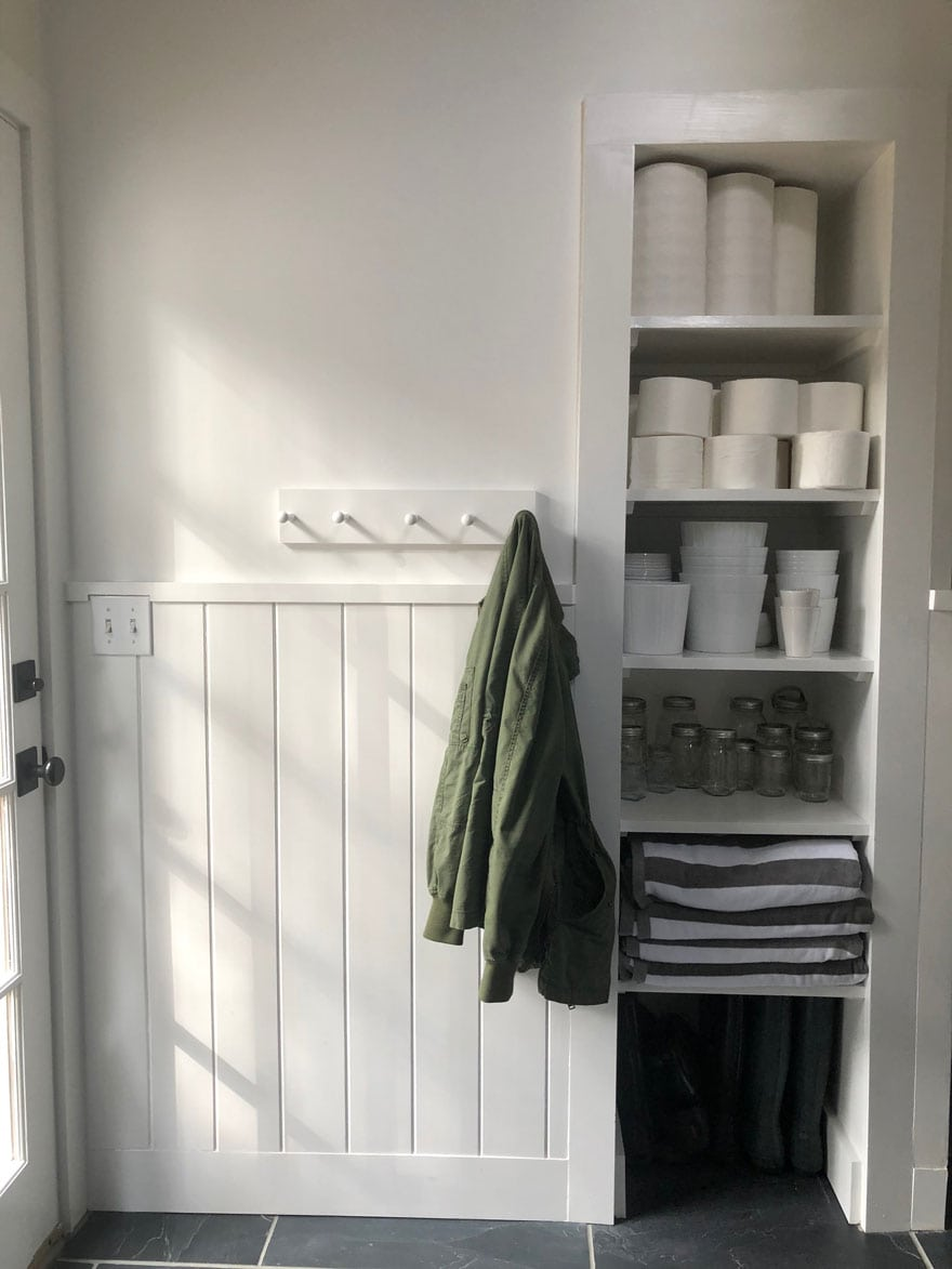 shelves with storage, green jacket on hook