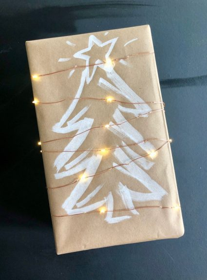 The Simplest Holiday Gift Wrap Using Kraft Paper And Lights