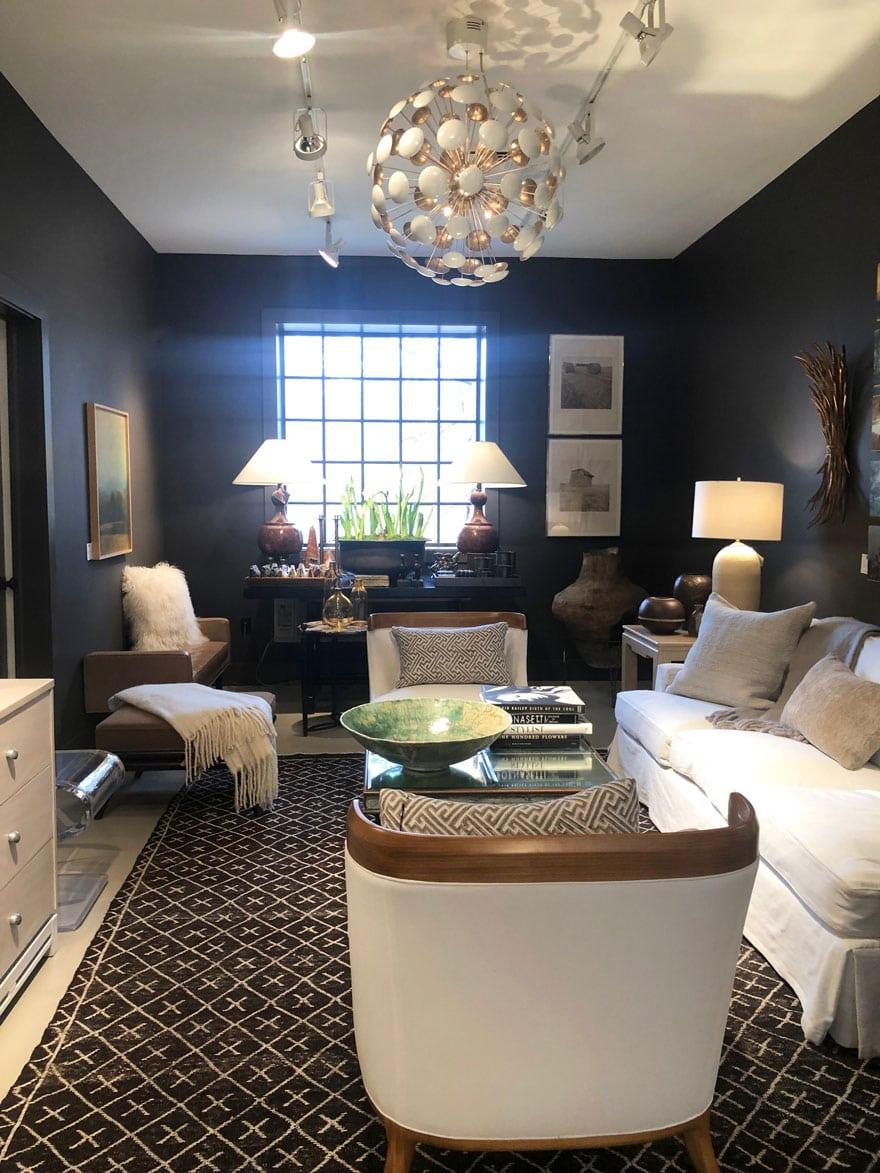black walls, chandelier, furniture, rug