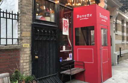 cafe with red sign door with bubble lights