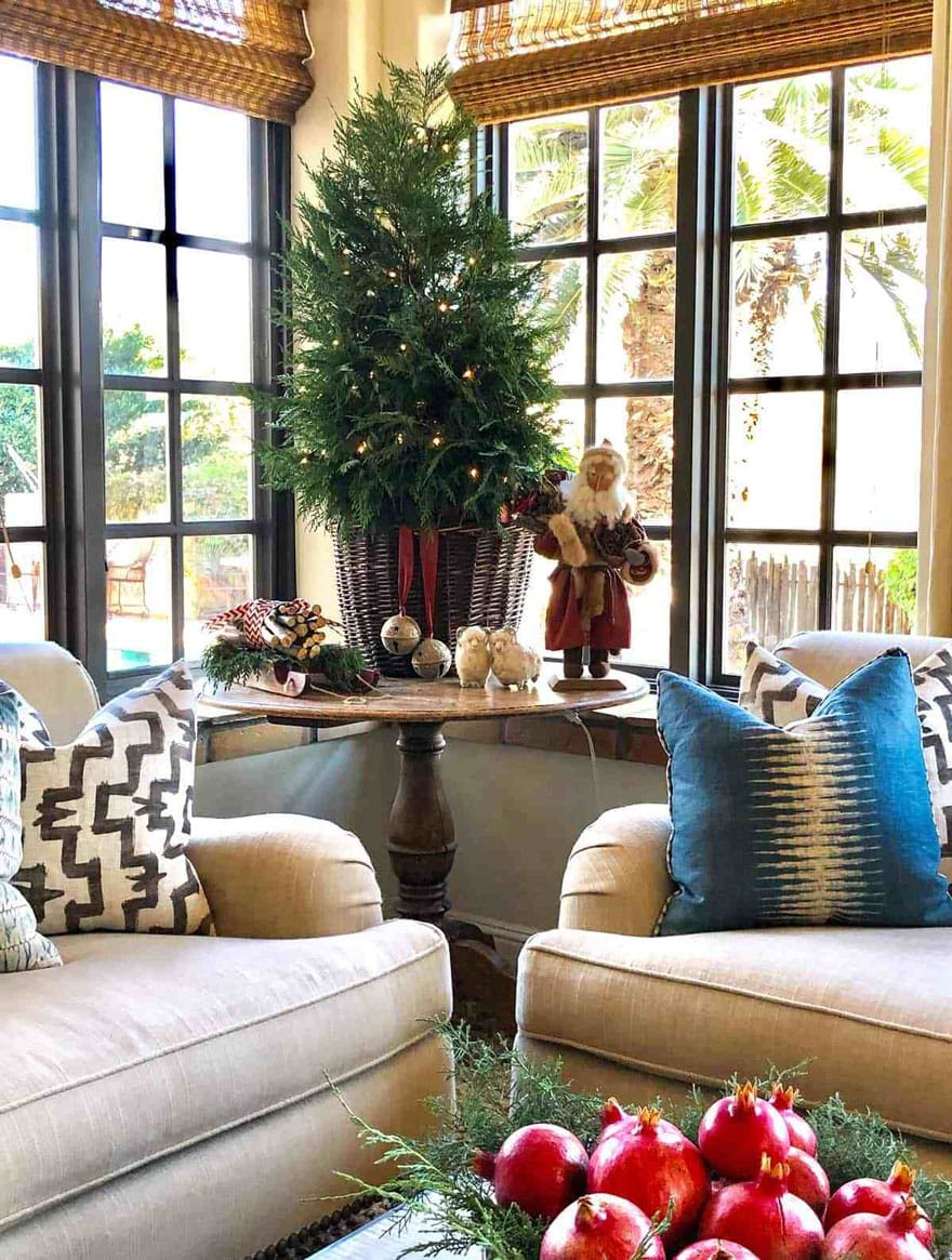 sofas, pillow and christmas tree on round table