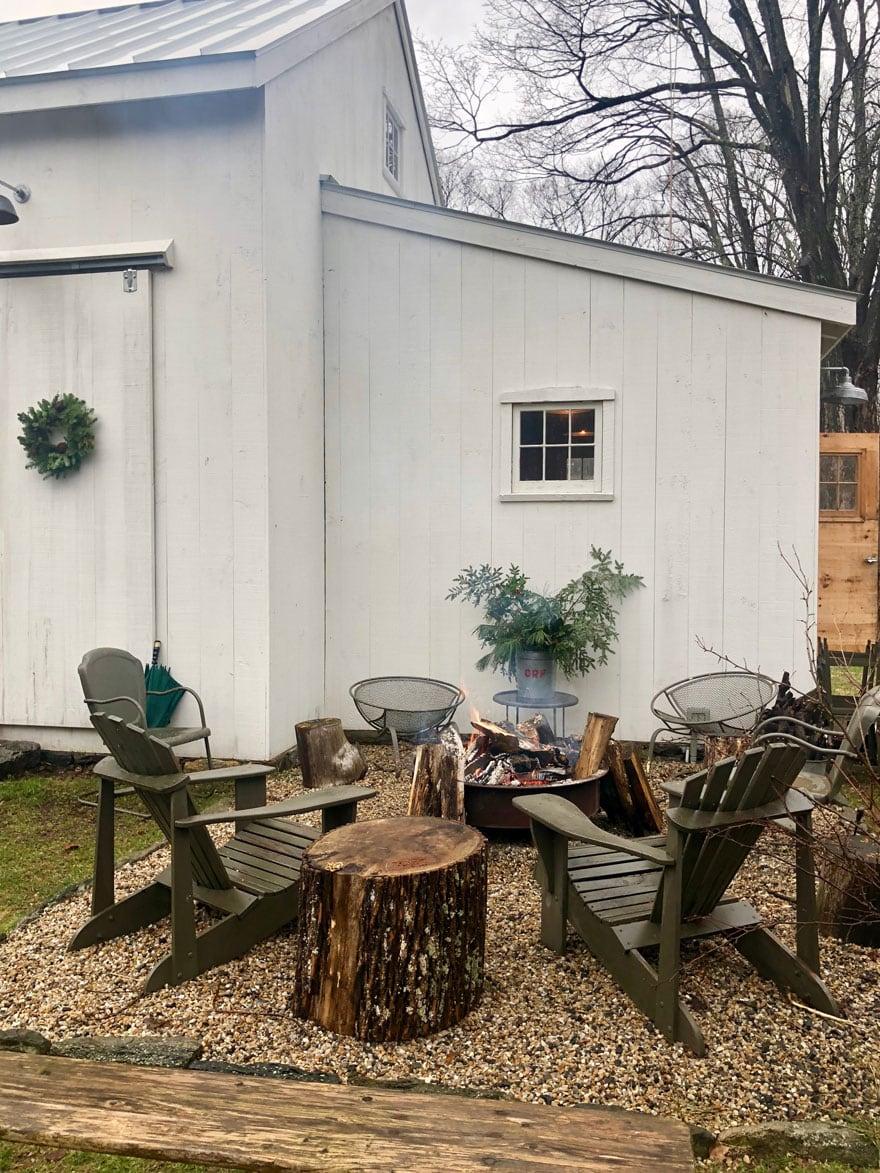firepit, white barn, chairs, wreath