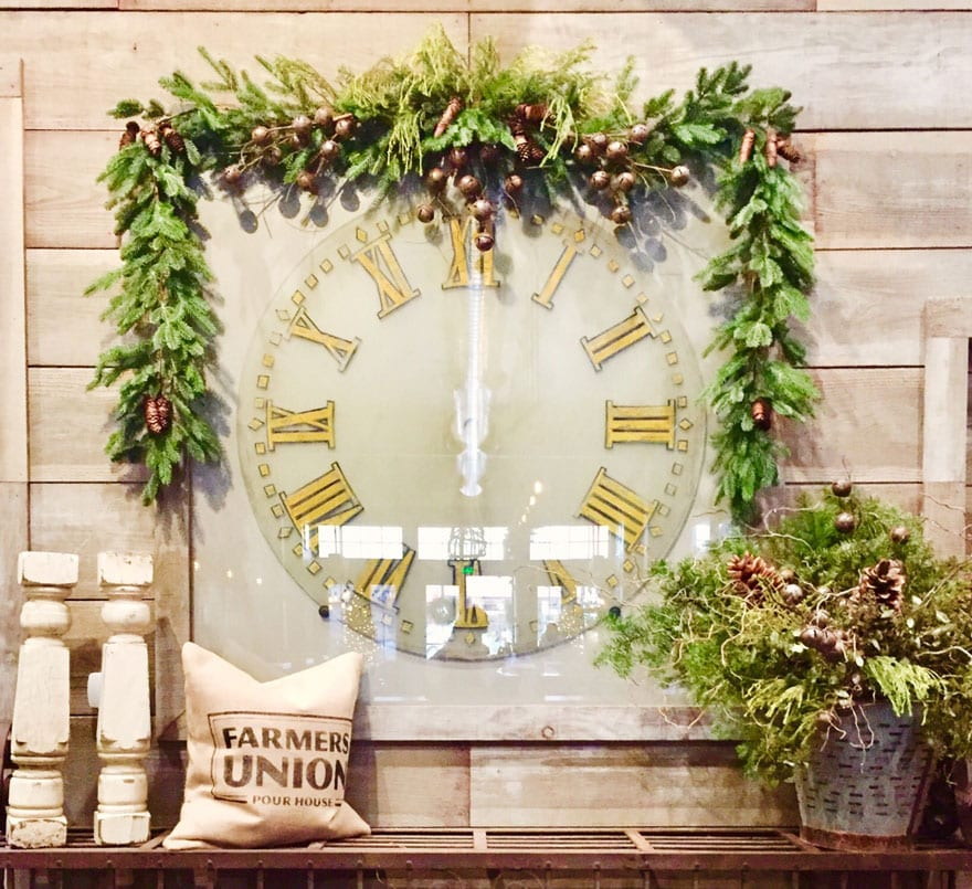 clock, greenery on shiplap