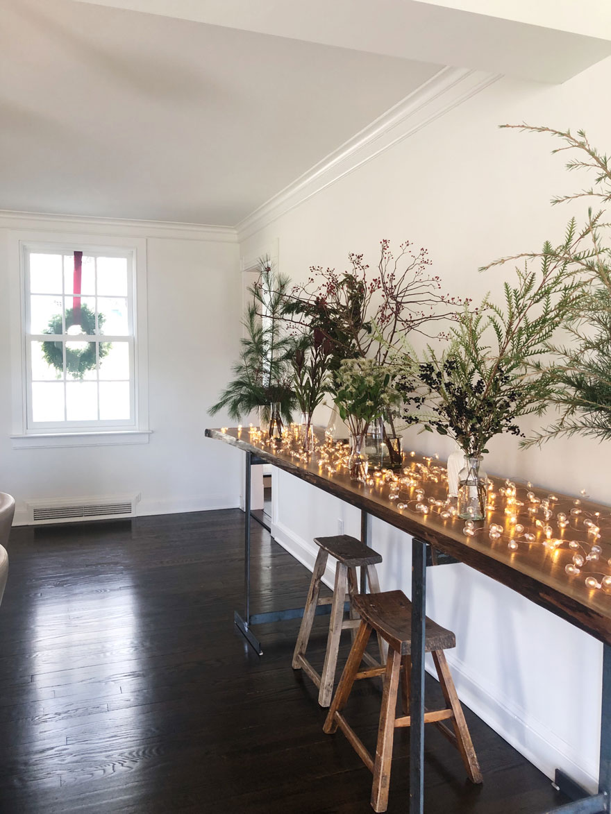 greens, vases, long table with window and wreath