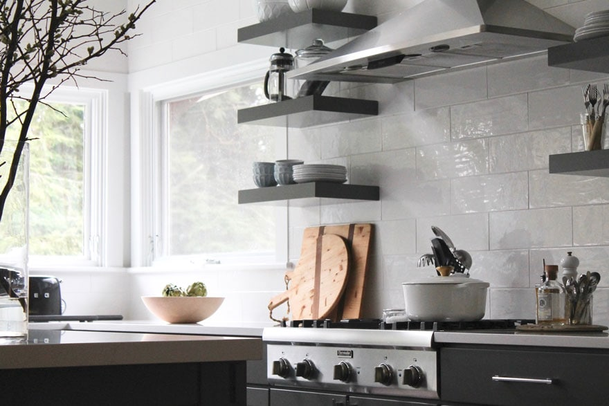 open shelving, cutting boards, stove top, wood bowl
