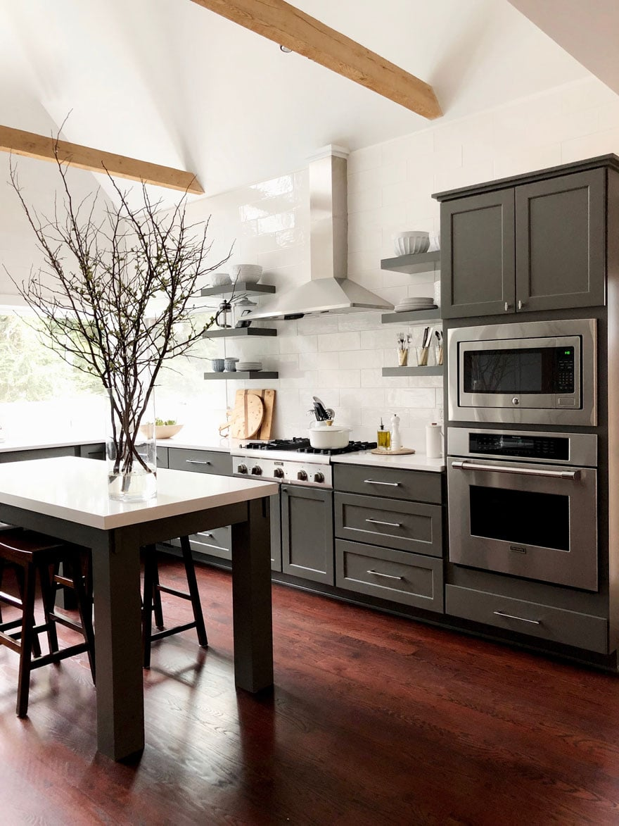 kitchen with built in ovens, painted gray cabinets, open shelving, kitchen island