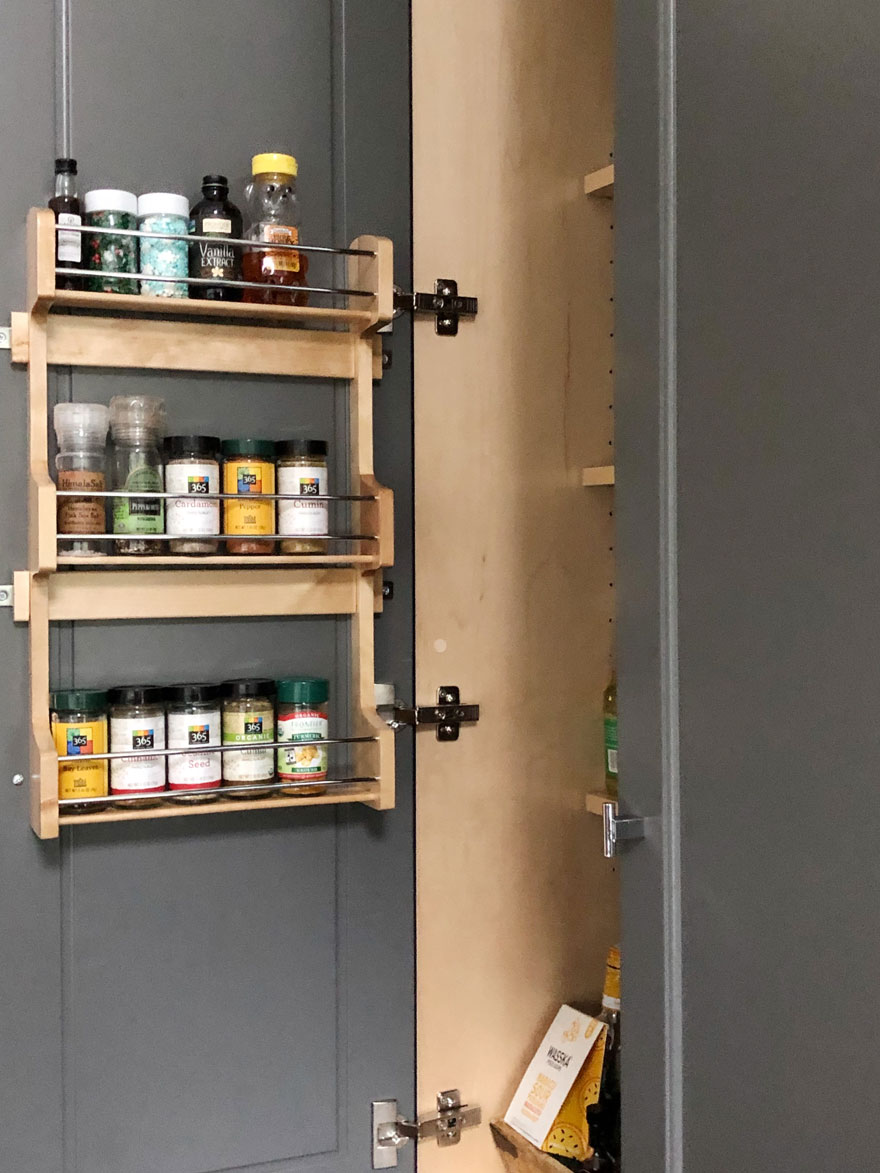 spice jars inside pantry cabinet door
