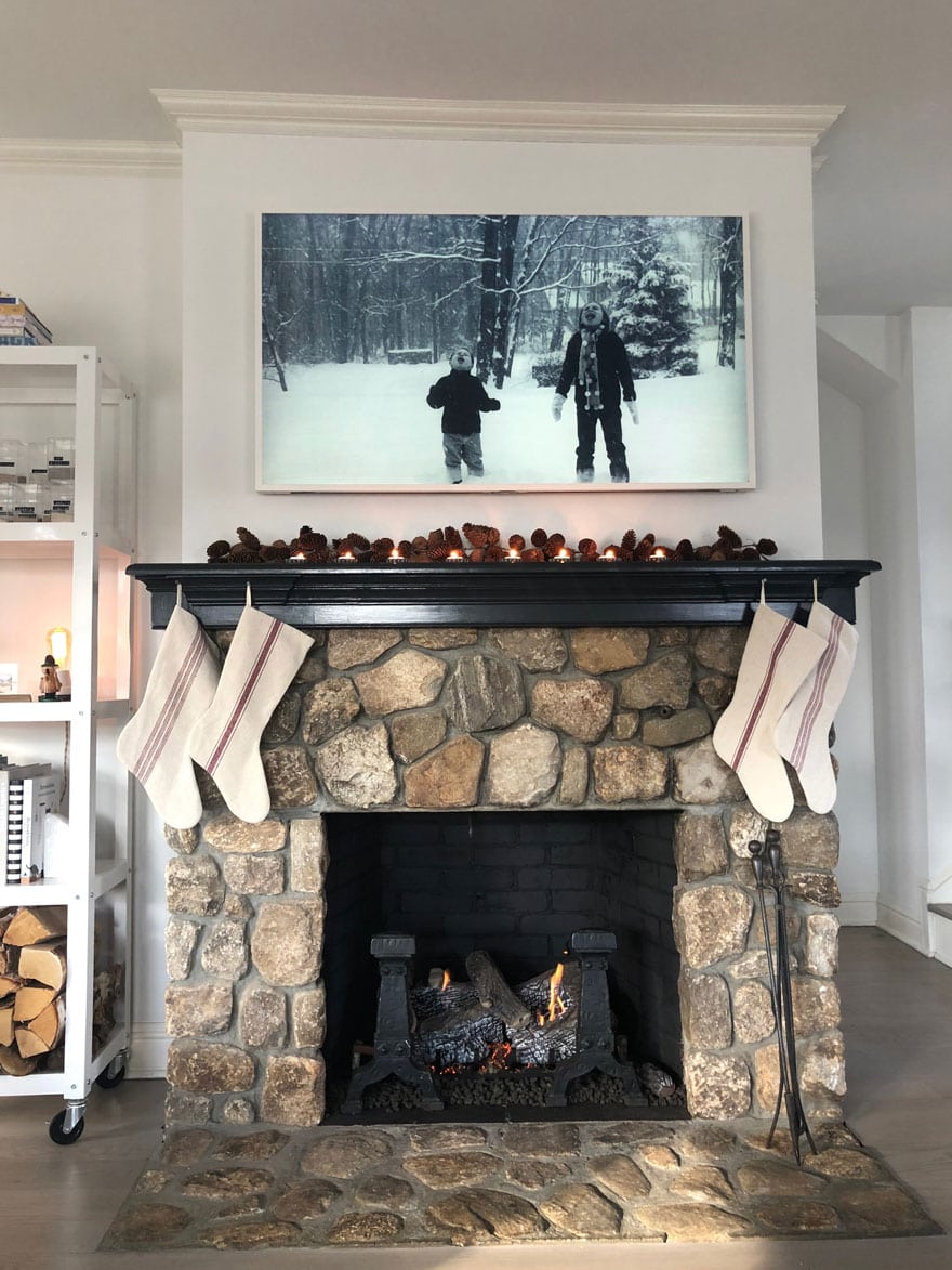 stone fireplace, black and white photo, holiday stockings