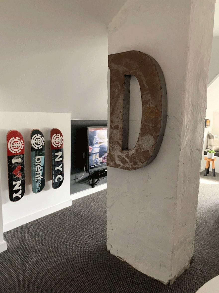 large letter D, 3 skateboard decks