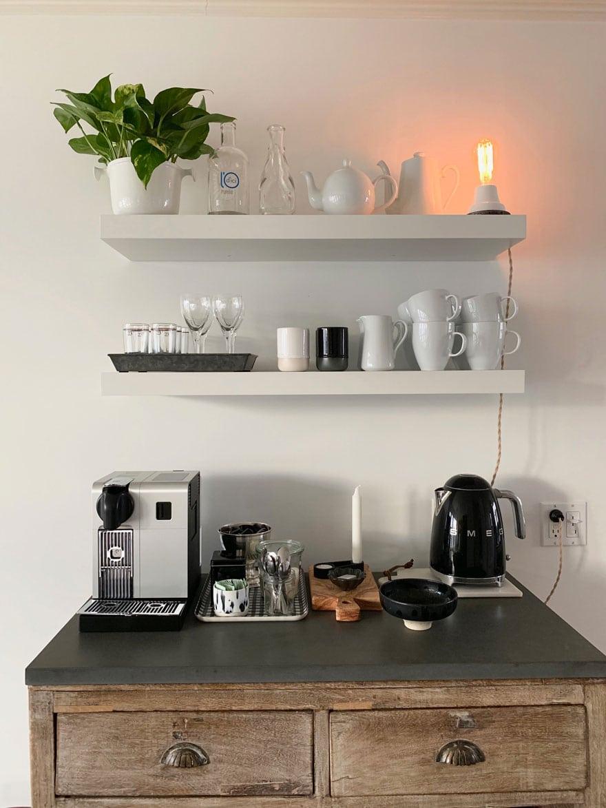 coffee maker, open shelving, plant, tea kettle