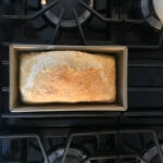 bread in loaf pan on stove top