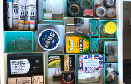 boxes in drawer with various miscellaneous items organized