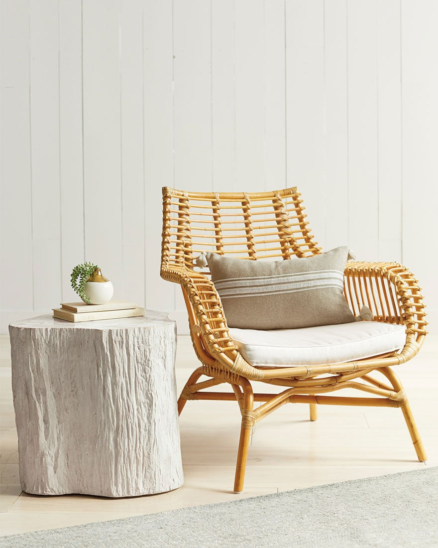 rattan chair, side table, pillow