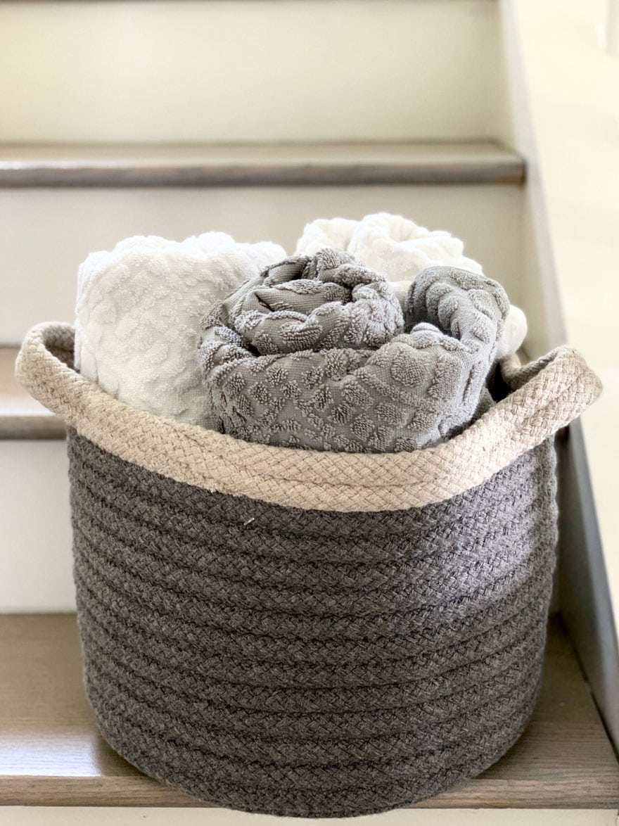 basket with towels on steps