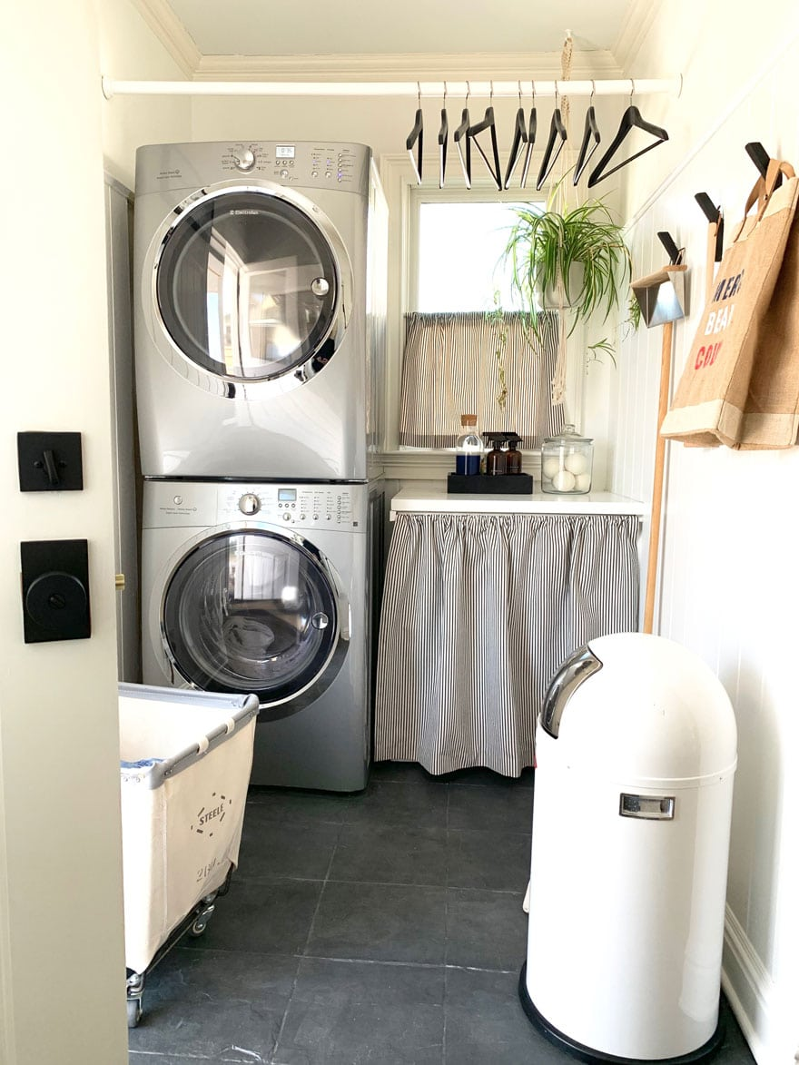 washer dryer, laundry cart, cafe curtains, hooks, trash can on painted gray floors