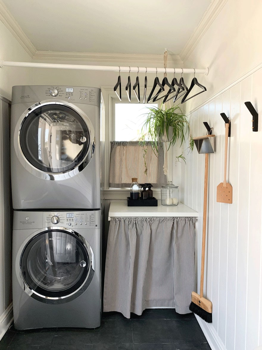 washer dryer, hangers on bar, hooks, window