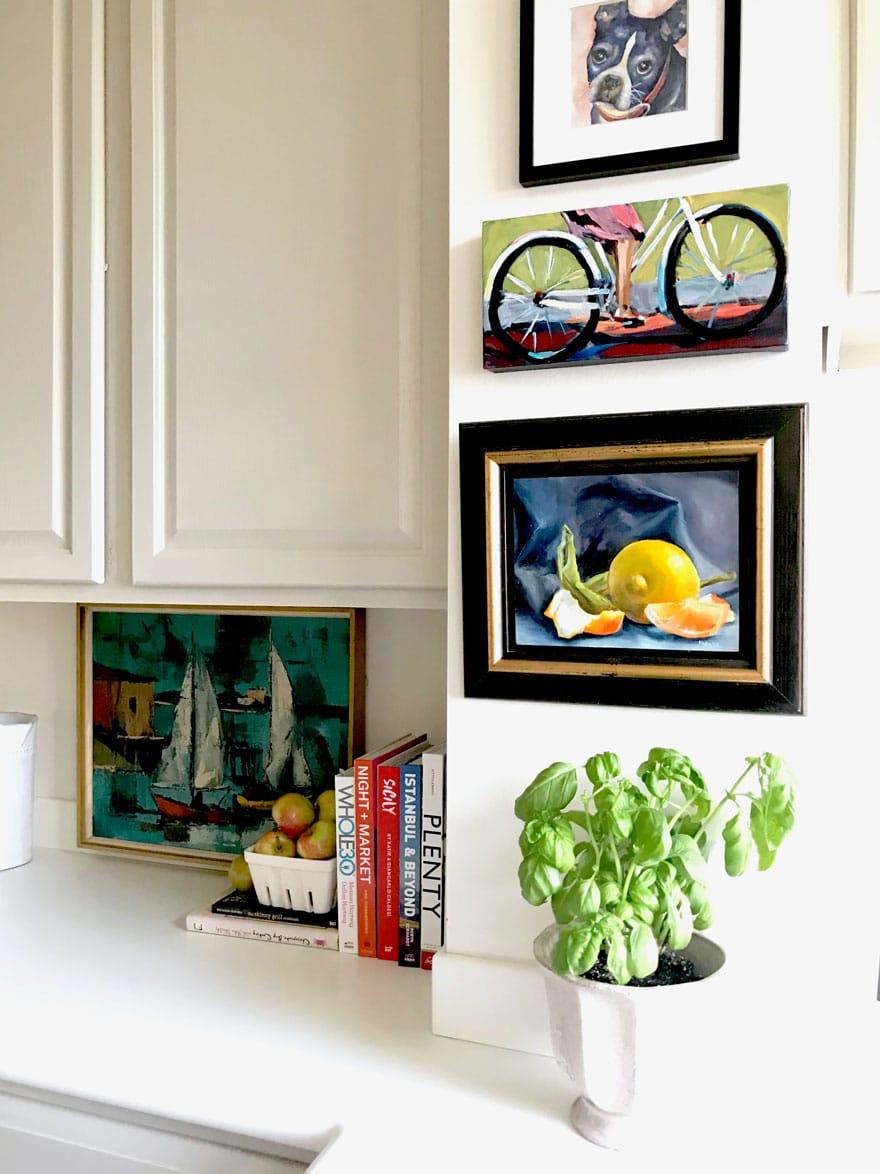 art, basil plant cookbooks on kitchen counter